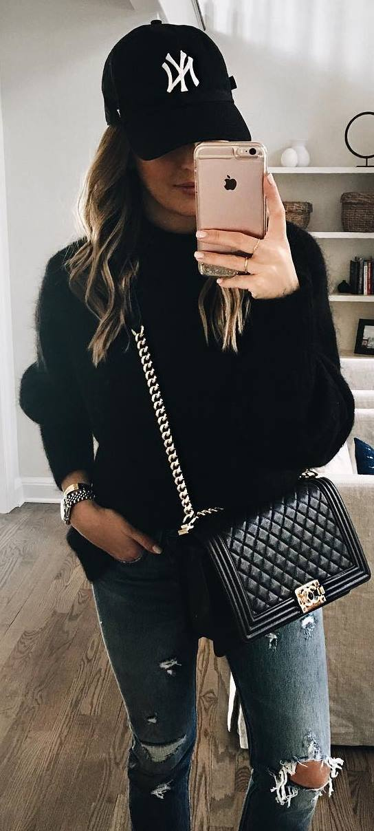 how to wear a hat + black bag + cashmere sweater + rips