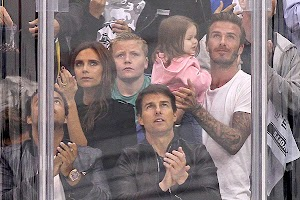 The family of Beckham and Tom Cruise with his son at a hockey game