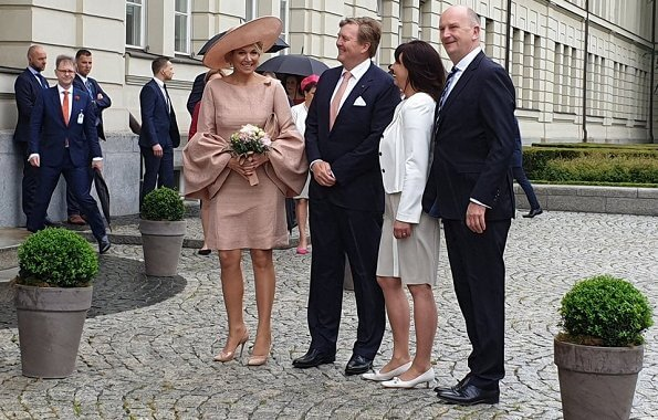 Brandenburg's Prime Minister Dietmar Woidke and his wife Susanne Woidke. Queen mMaxima wore Natan dress