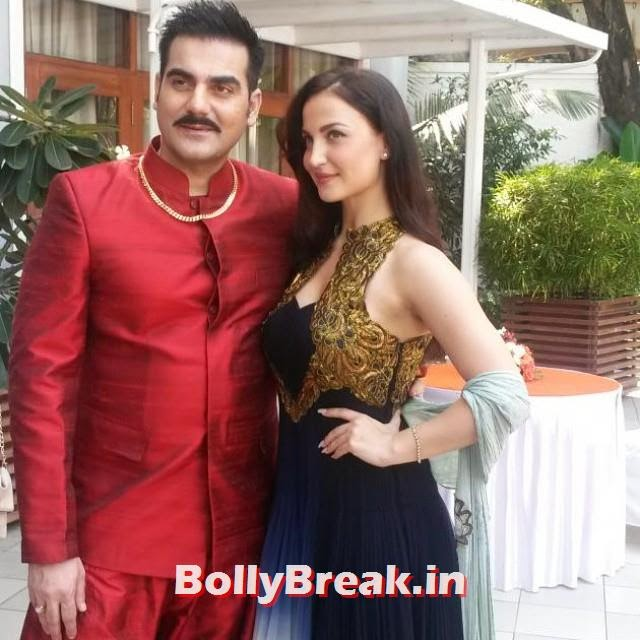 @elliavram and arbaaz khan, at mu hur at, of new, bolly d mo vi i, direct ed, by abbas must an, elli avram, s tun nin , in blue ana r kali, with golden halter, dress from a ha z ai i, also co starring kapil sharma, all the best, to entire ream 👍👍, Elli, Kapil Kis Kis Ku Pyaar karu Movie Muhurat pics