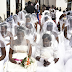 200 Brides Paraded on 5 Flatbed Trailers in Ugandan Mass Wedding (Photos)