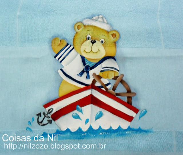 ursinho marinheiro no barco