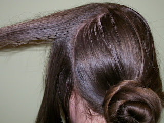 Side hair divided into upper and lower sections for use in rolls.