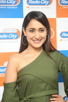 Pragya Jaiswal in a single Sleeves Off Shoulder Green Top Black Leggings promoting JJN Movie at Radio City 10.08.2017 127.JPG
