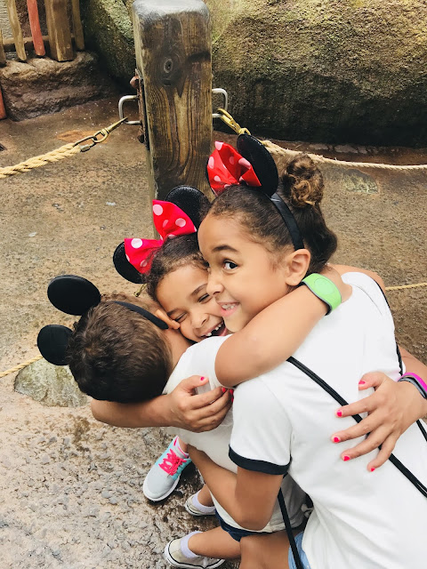 Kids hugging at Walt Disney World