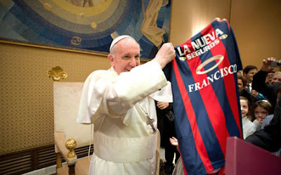 Pope and football shirt