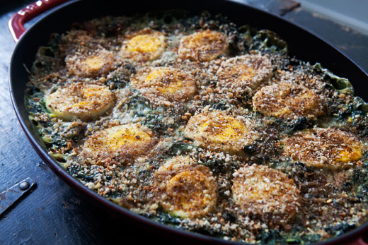 This spinach gratin casserole topped with bread crumbs and hard boiled eggs is out of this world.