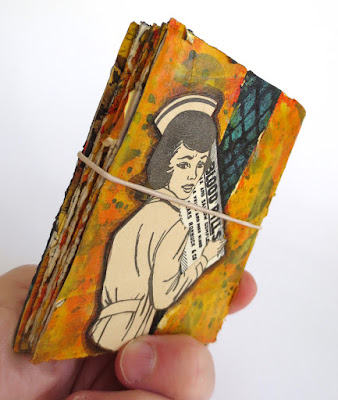 Handmade collaged accordion book about snakes