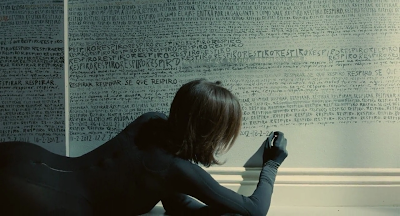 The Skin I Live In 2011 film Pedro Almoldovar screenshot elena anaya vera drawing wall pencil