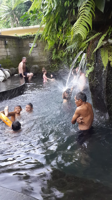 fun, happiness of children playful in Tegenungan Waterfal, Bali,Indonesia