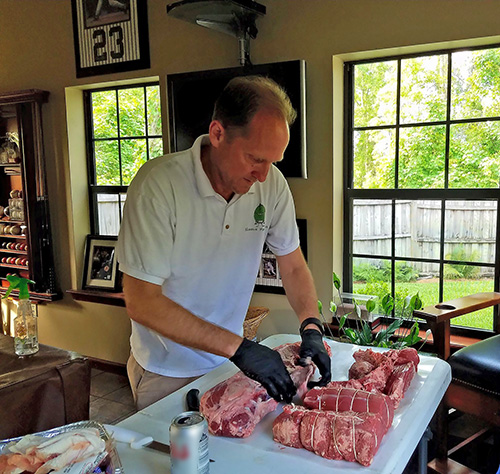 Nibble Me This', Chris Grove, preparing Certified Angus Beef tenderloins for the Eggfest.