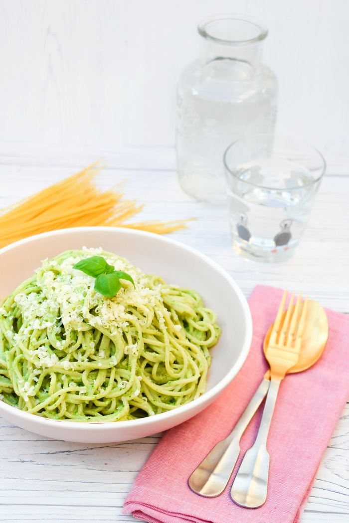 Kale and Cashew Pesto Spaghetti topped with grated parmesan and fresh basil