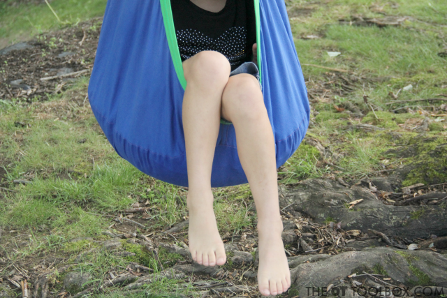 Use an outdoor sensory swing like the Harkla pod swing for calming sensory input when outside.