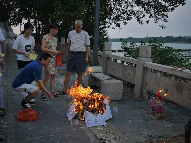 people burning ghost money in Ganzhou