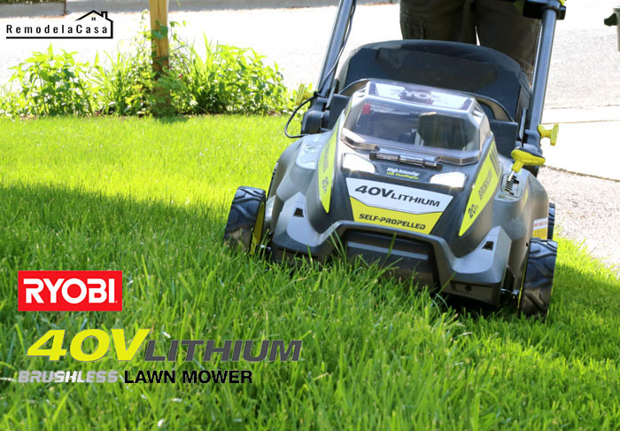 Cutting the grass with a self-propelled Ryobi mower