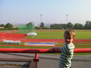 athletics, running track with shot putt, long jump