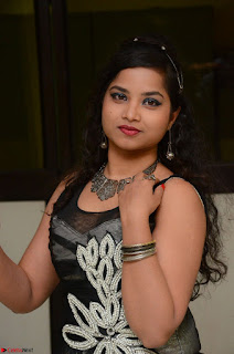 Shrisha Dasari in Sleeveless Short Black Dress At Follow Follow U Audio Launch 040.JPG