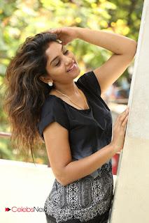 Actress Karuna Pictures in Jeans at Tholi Kiranam Press Meet  0059