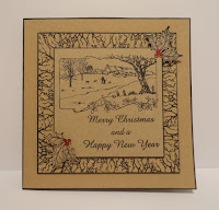 Christmas card on kraft card with black stamping and red holly berries