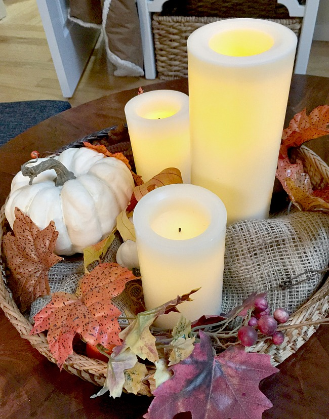 Faux candles and foliage create a one of a kind lasting centerpiece for a round table. www.homeroad.net