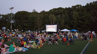 the crowd gets settled for the movie. A preview roll touted the #shopFranklin businesses helping to put on the event