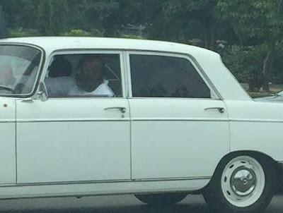 Dino Melaye cruises Abuja street in classic Peugeot 404 car,Dino Melaye cars,