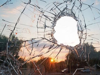 Glass Window with a Hole Smashed in It