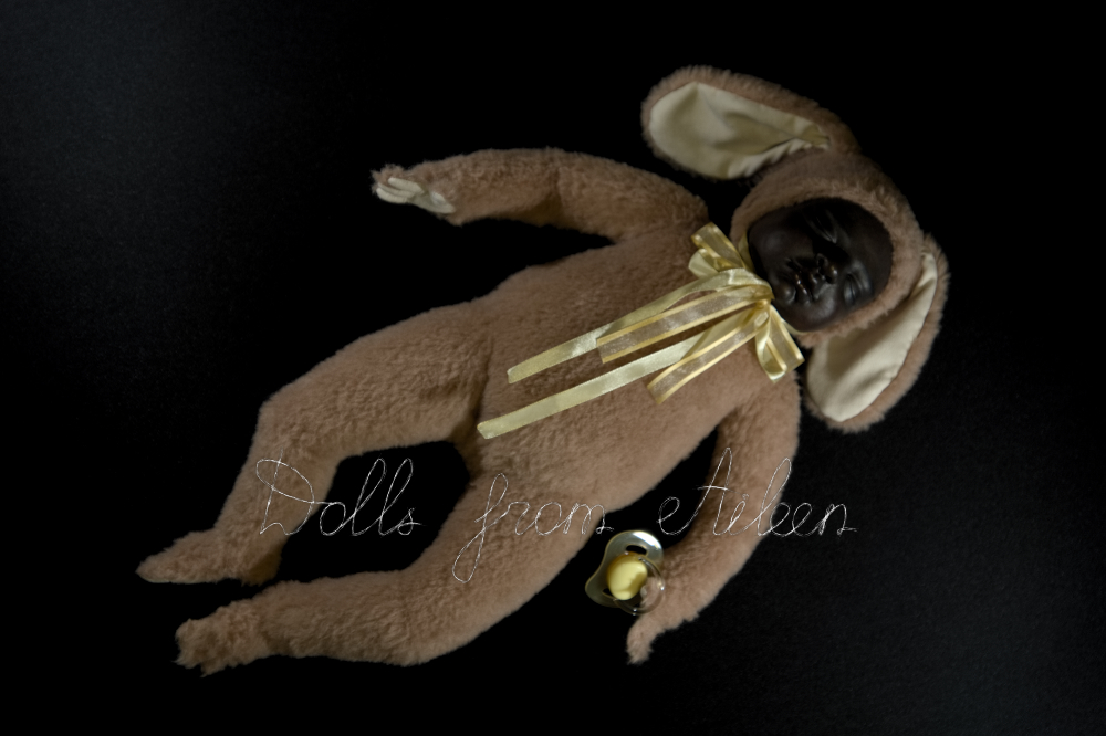ooak baby teddy doll holding pacifier