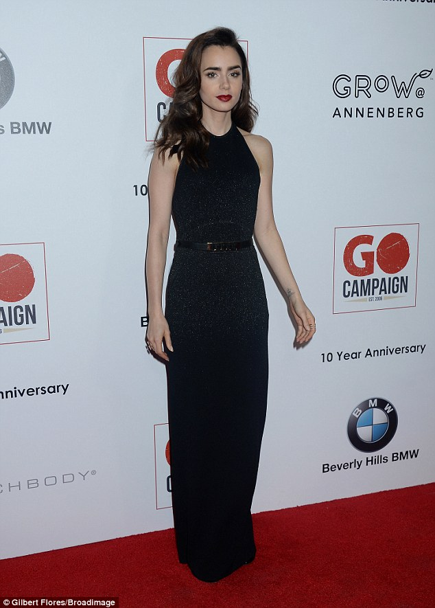 Lily Collins wears sexy backless gown to the GO Campaign Gala in LA