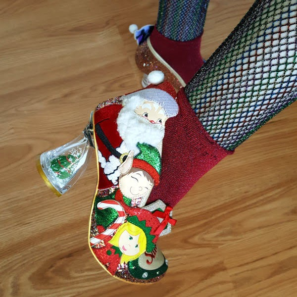close up of christmas shoe on foot with Santa and elf applique characters and perspex christmas tree heel