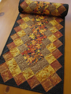 https://www.patchworkmountain.com/collections/table-runners/products/fall-leaves-quilted-table-runner-5