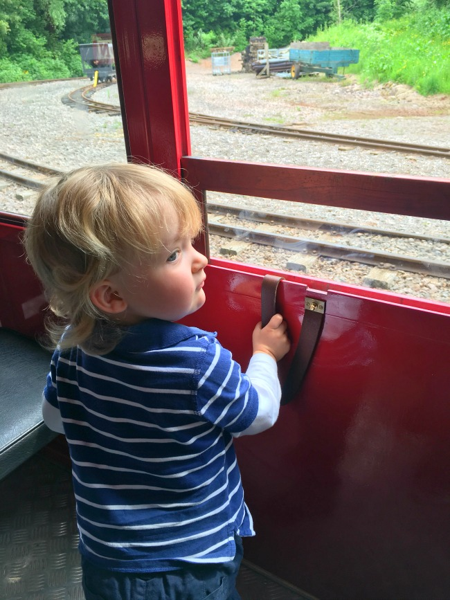 trains-and-trampolines-toddler-on-train