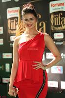 Meenakshi Dixit in Red One Shoulder Red Zipped up gown at IIFA Utsavam Award 75.JPG