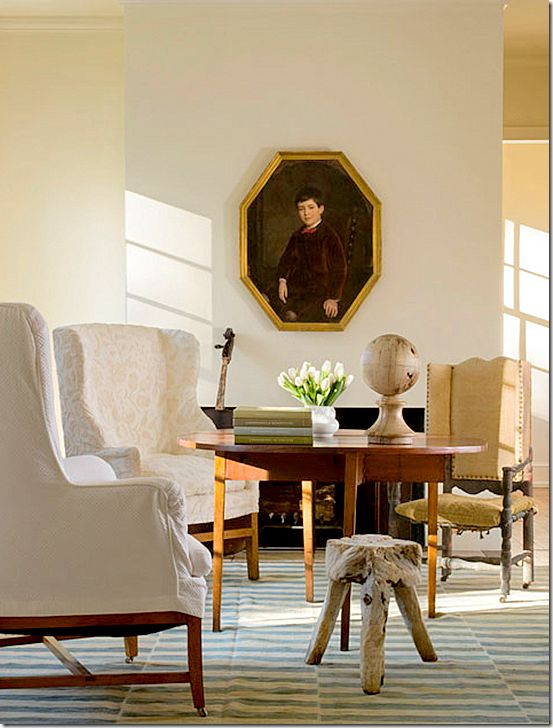 Antiques, classic interior design, and stripe rug in a space by Pamela Pierce.