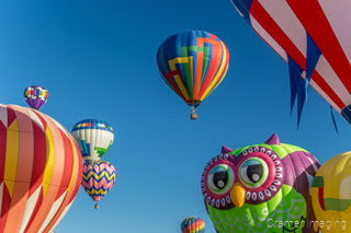 Cramer Imaging's fine art photograph of many hot air balloons taking flight in Panguitch Utah with a blue morning sky