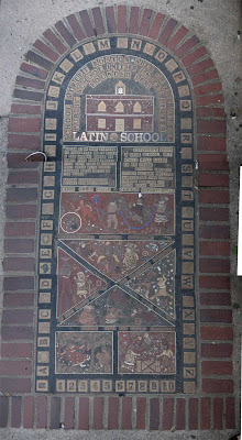 Bricks, brass and stone art marking the Boston Latin School location