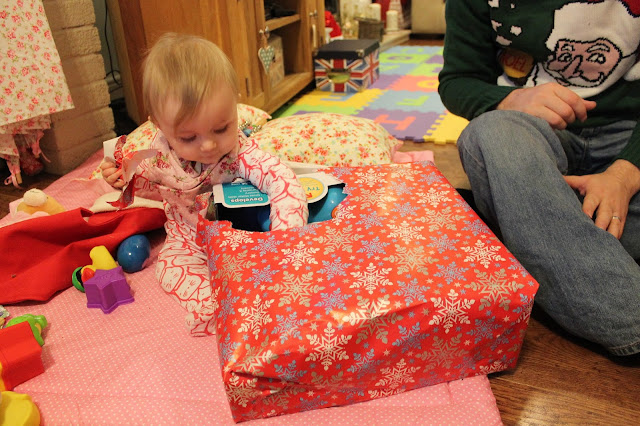 baby opening christmas presents