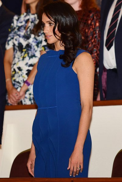 Meghan Markle wore a royal blue midi dress by Jason Wu, Aquazzura Portrait Lady pumps, she carries DIOR Navy Satin Clutch Bag