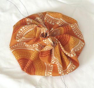 DIY spiced fabric pumpkins fall centerpieces - pull the thread tight to make a pouch