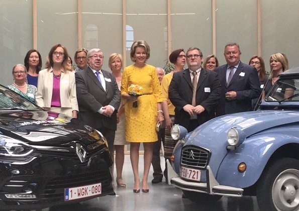 Queen Mathilde visited the Wit-Gele Kruis (White-Yellow Cross) in Gent. Queen wore Natan Dress and Delphine Nardin Gold Earrings