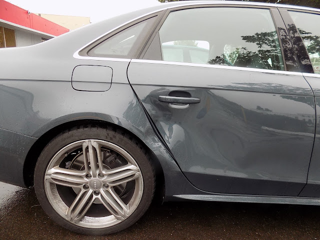 Collision damage on Audi S4 before repairs at Almost Everything Auto Body.