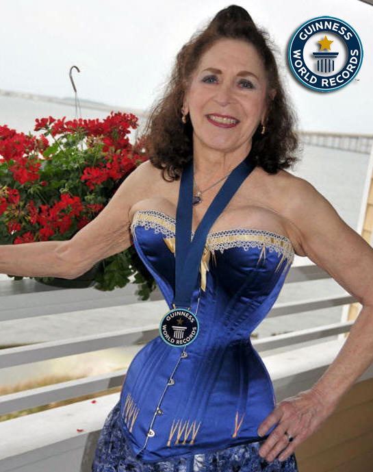 Cathie Jung wearing the medal awarded to her by Gunness World Records.