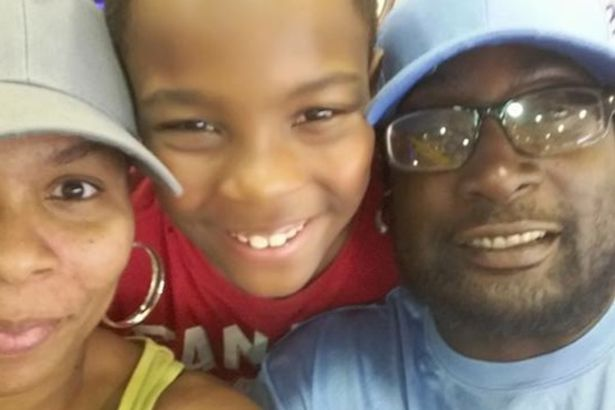 A black man fatally shot by police in North Carolina was reading a book and waiting for his child to get off a school bus, his family claim.