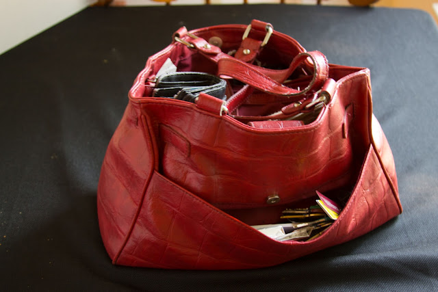 red purse filled with stuff