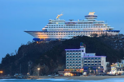 In South Korea at the top of a cliff is the Sun Cruise Hotel ship.
