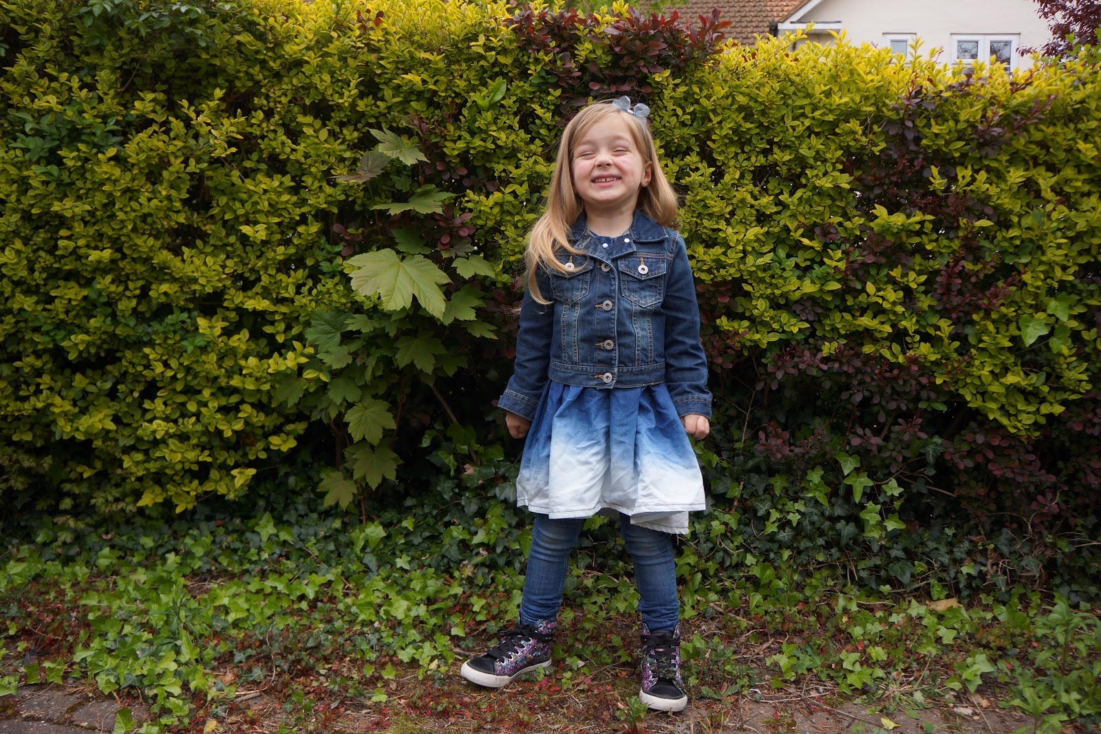 four year old girl in a denim dress