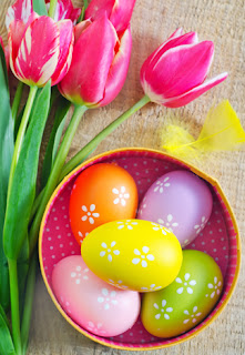 Photo of a Bowl of Easter Eggs and Tulips