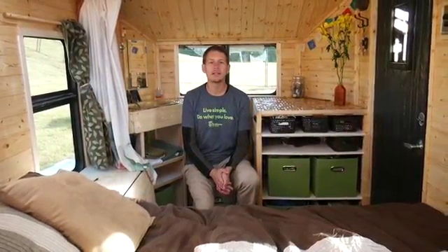 04-Richard-sitting-on-the-Composting-Toilet-Terraform-Tiny-House-on-Wheels-Sustainable-Architecture-www-designstack-co