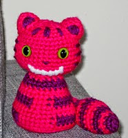 http://www.ravelry.com/patterns/library/cheshire-cat-9