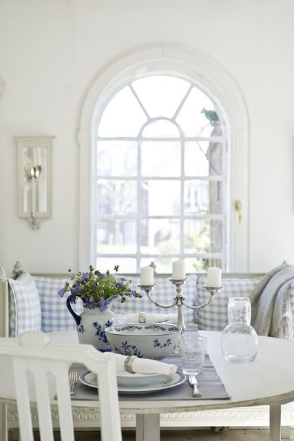 Light blue and white check banquette in Swedish breakfast room - found on Hello Lovely Studio
